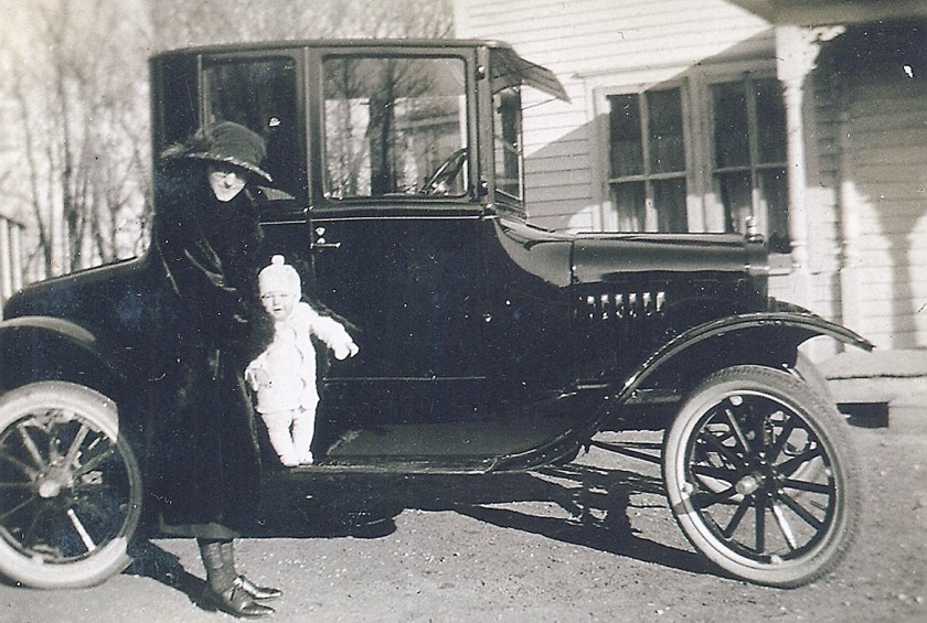 Baby on running board, 1924