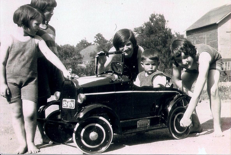 Boy in fancy toy car (no info)