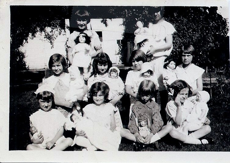 Girls at 1929 party w: dolls (front)