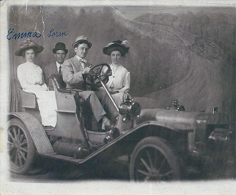 Loren and Emma in sporty car, Winnebago, MN